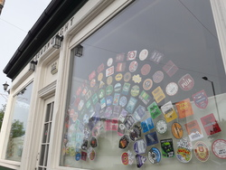 Beer coaster rainbow in window of Dreadnought pub