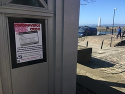 Poster for mutual aid scheme during coronavirus lockdown, police box, Newhaven Harbour