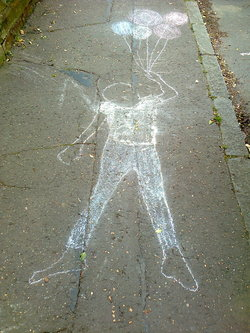 Chalk figure with balloons