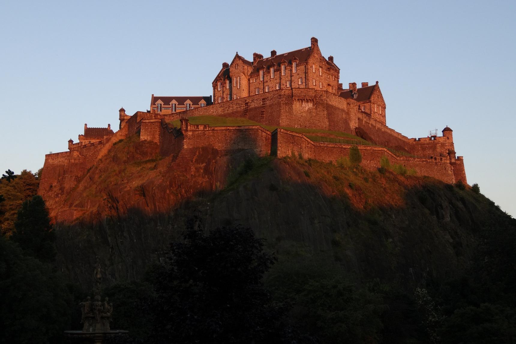 Edinburgh Castle bathed in golden sunset