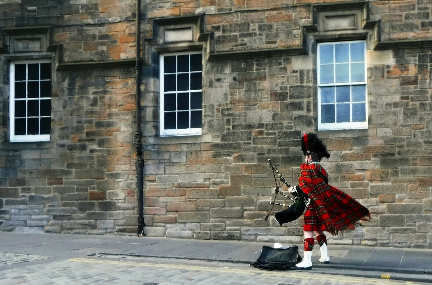 Energy of Tartan.The Bagpiper at Edinburgh Castle.