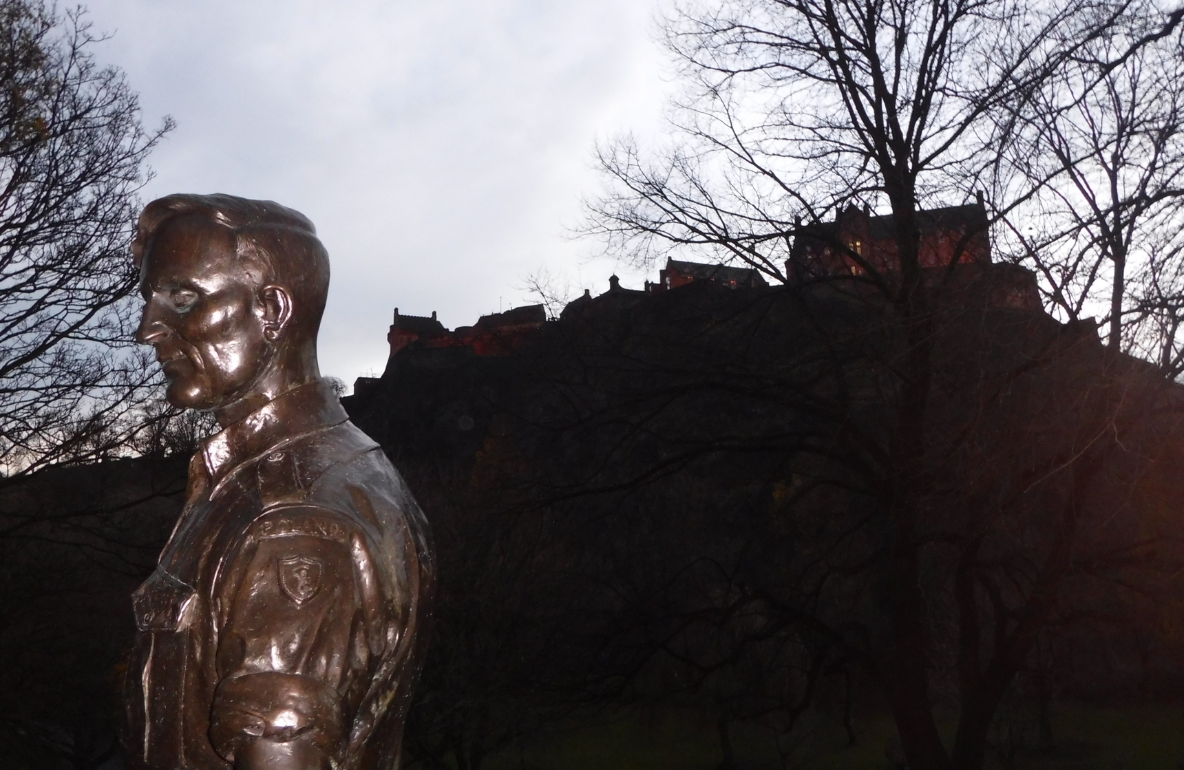 The witnesses. The part of Wojtek's the Bear Monument in Princess  Gardens with Edinburgh Castle in the background.