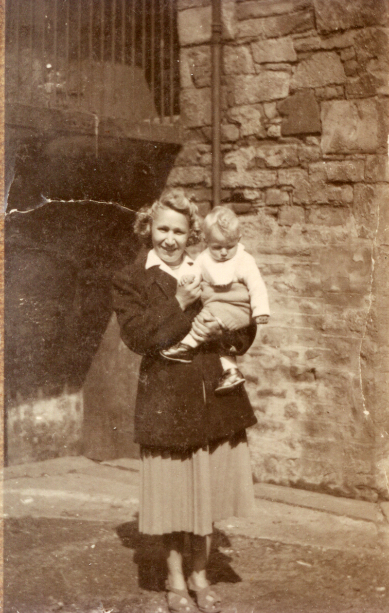 Mother Standing In Courtyard With Her Young Son c.1952