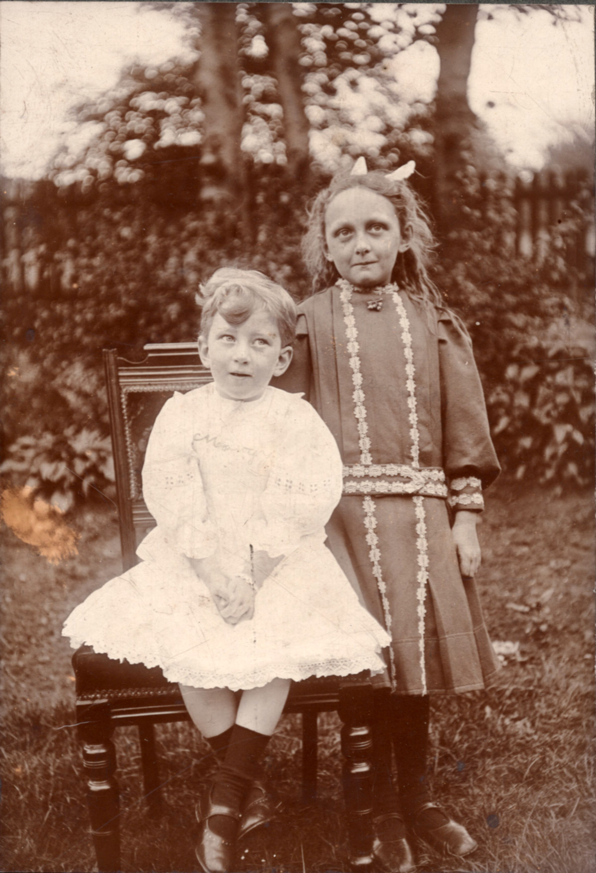 Two Edwardian Girls Standing In Garden 1910s