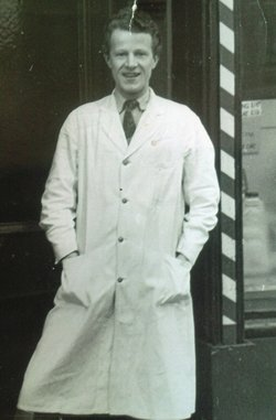 Photo of our Father at the front door looking very young and pleased with himself,