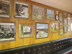 Photographs on the wall of my Father's Shop in the West Port including some amateur paintings.