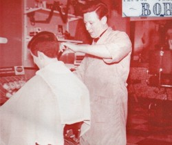 Jimmy Chapman cutting Charlie Mearns hair.