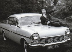 Our father sitting on the bonnet of his left hand drive Vauxhall Cresta