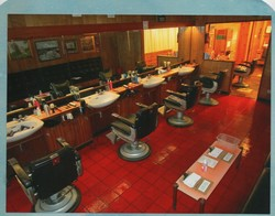 Interior of the Shop - 5 barber chairs with a front washing basin in front.