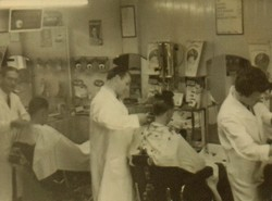 Our Father cutting hair on the right with 2 other Barbers.