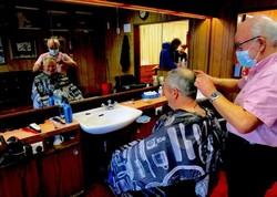 David Turner cutting Alan Orr's hair, a loyal customer for 40 years.
