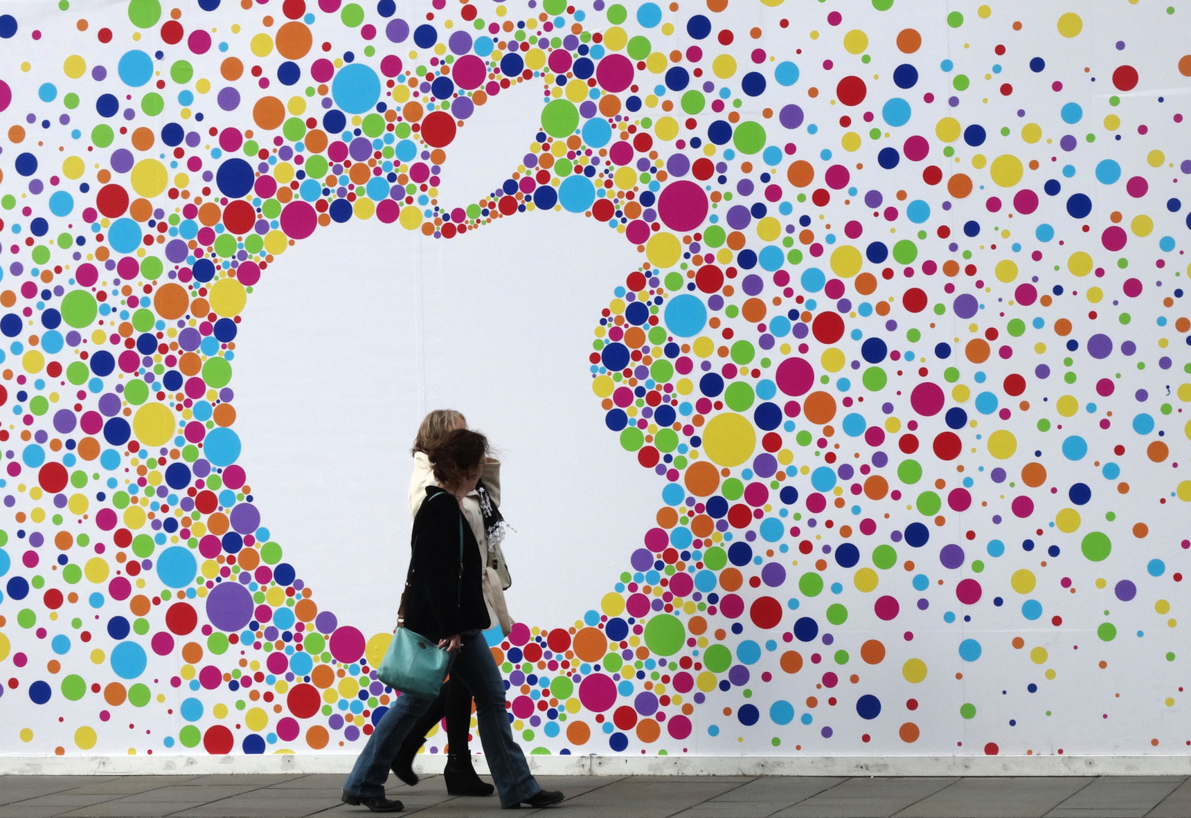In front of the apple