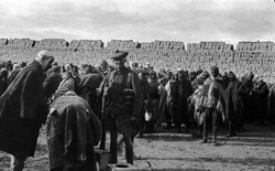 Soldier Of The 7th Royal Scots Guarding Turkish Prisoners At El Arish In The Sinai 1916