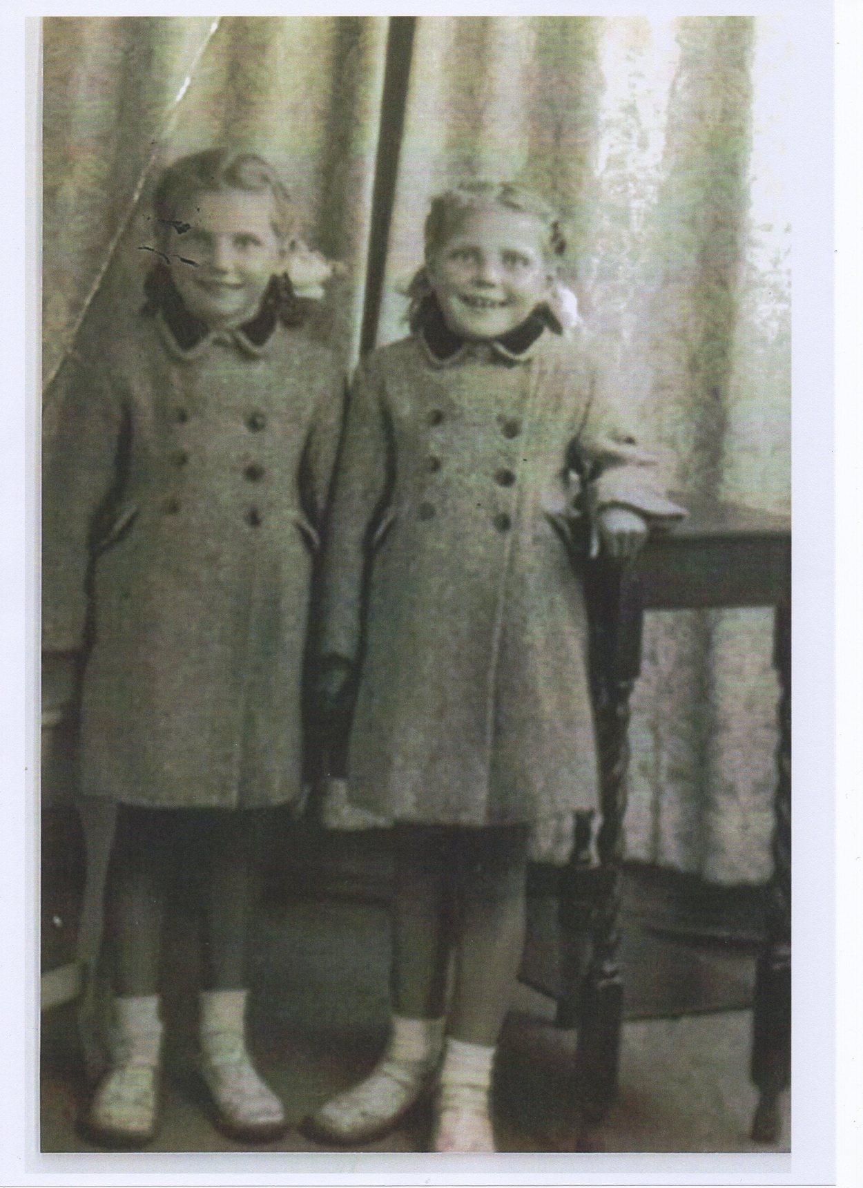 The Twins smartly dressed in their Tailored Coats,