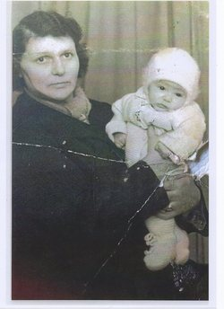 Studio photo of my Mum holding my Brother Billy.