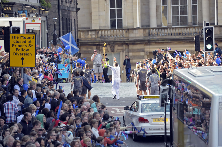 Olympic Torch Runner and security officers, George IV Bridge