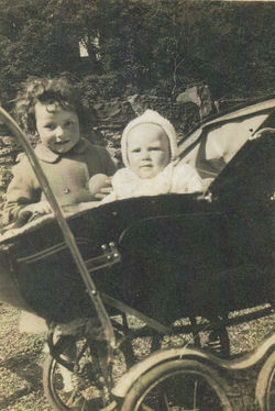 Me in my pram age 9 months, with my Sister Avril