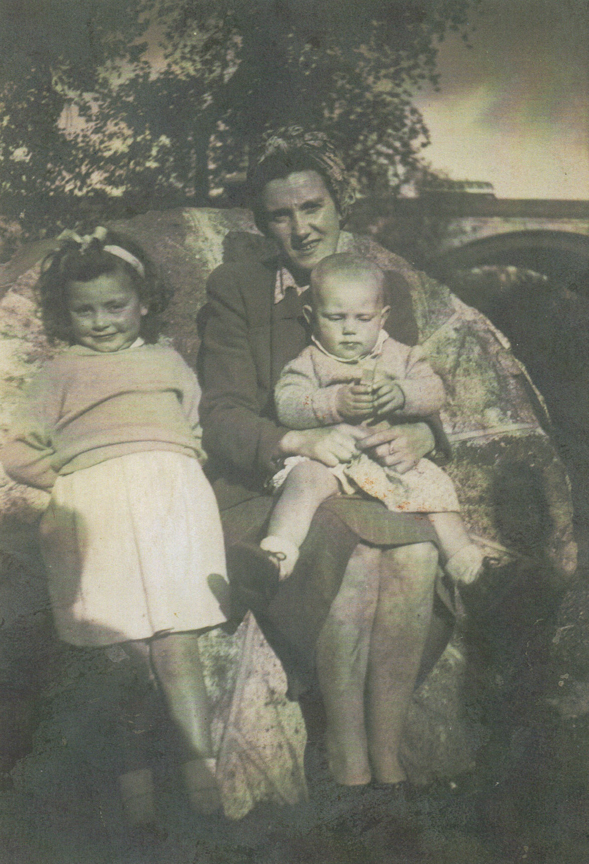 Left to right my Sister Avril, Mum and Me, on Mum's knee at the Wheel.