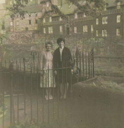 "Mrs Lee with her daughter Pat pictured ""Round the Gardens"" in the Well Court."