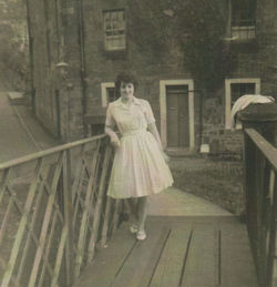 Photo of Pat Lee standing on the Wooden Bridge, with Hawthorn Terrace in the background.