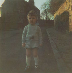 Our daughter Gillian age 2 years pictured near her Dean Path, Dean Village home which is  in the background
