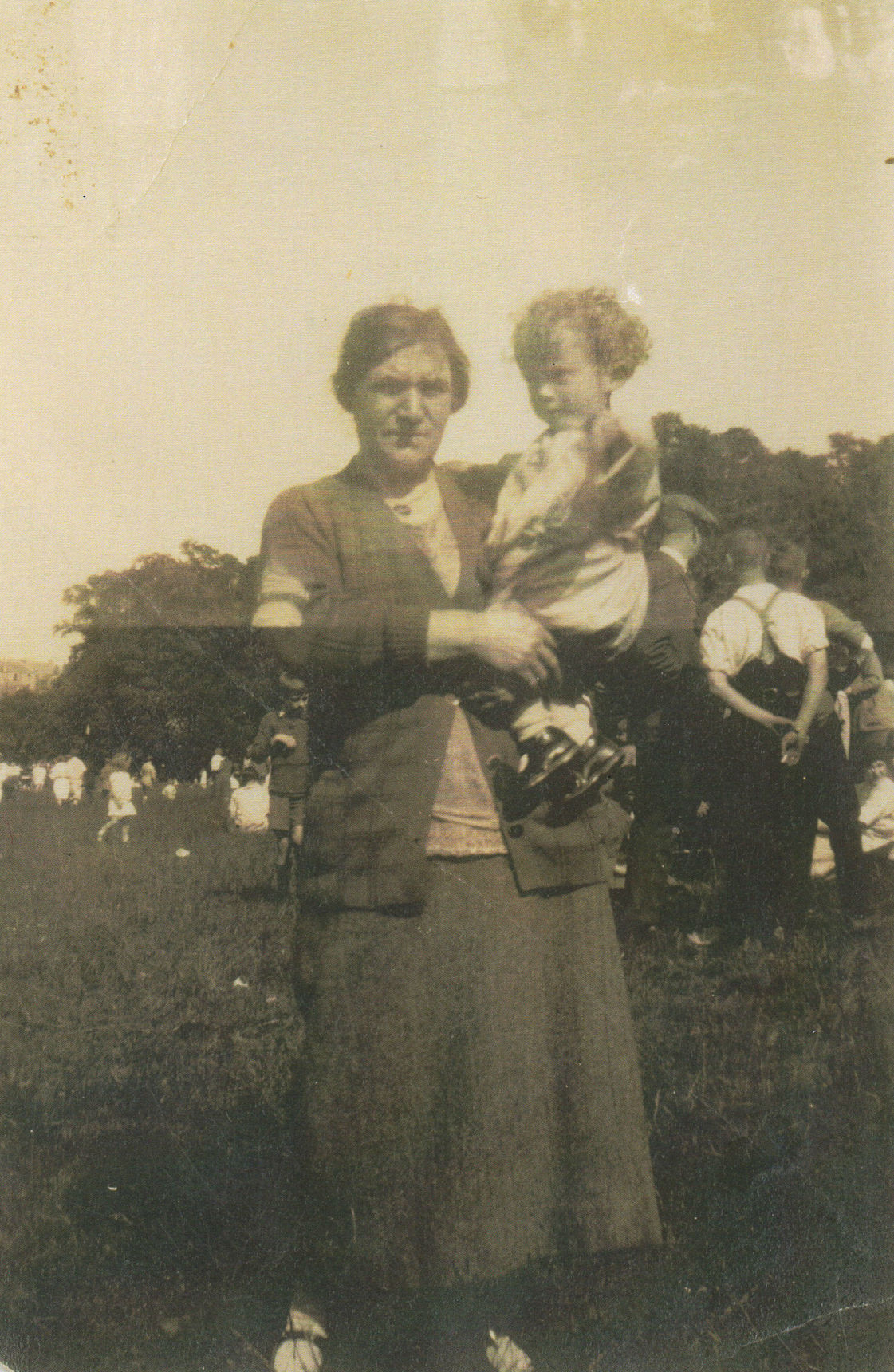 My Granny Boswell holding my Brother George at a Sunday School Picnic.