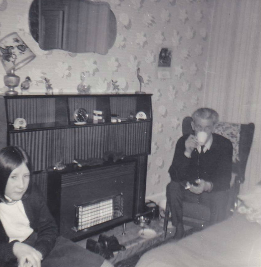 Me on the left and dad drinking a cup of tea in our house in Well Court.