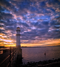 Newhaven Harbour lighthouse at dusk