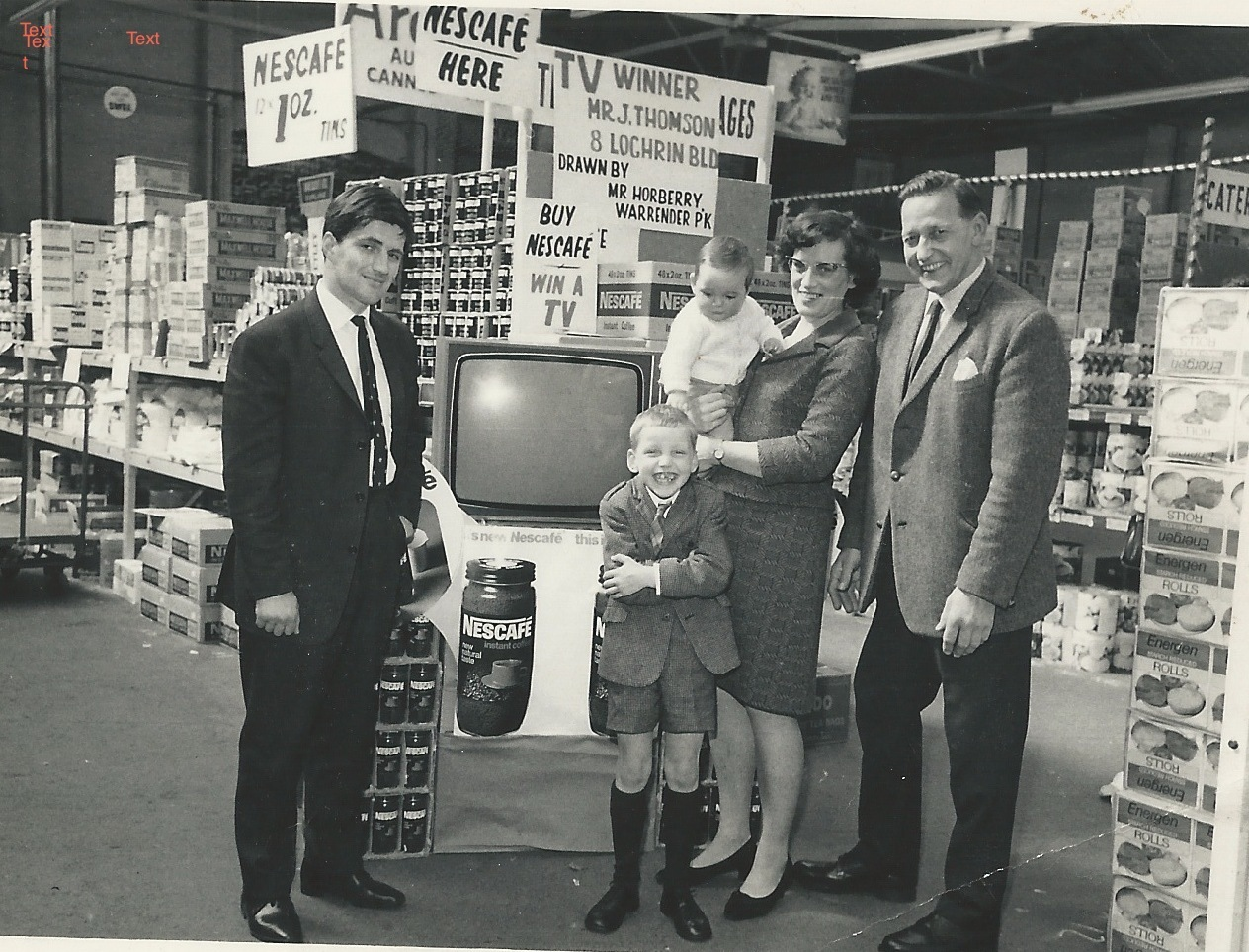 Cash & Carry Slateford Road - Charlie Taylor (owner of James Thomson & Sons Ltd) winning a TV in a Nescafe prize draw competition