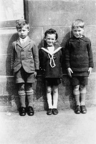 Three Young Boys Standing In A Row At Elgin Terrace c.1926