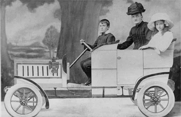 "Studio Portrait Woman And Children In A ""Car"" 1910"