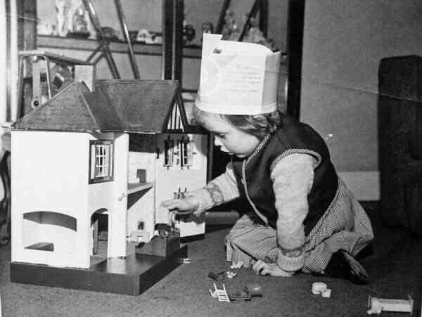 Girl Playing With Doll's House, early 1950s
