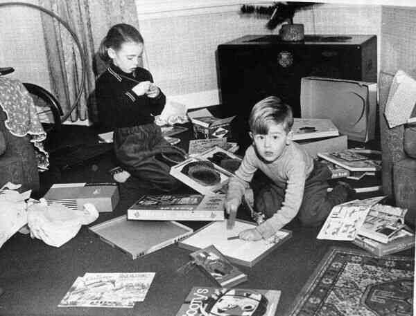 Brother And Sister Playing With Their Christmas Presents c.1955