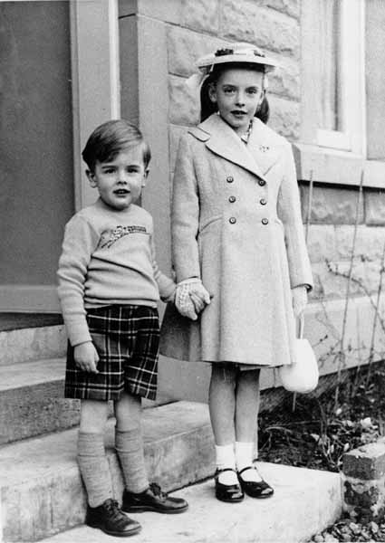 Well-Dressed Children On The Front Steps c.1958