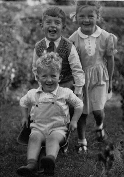 Children At Play Running With Wheelbarrow c.1950