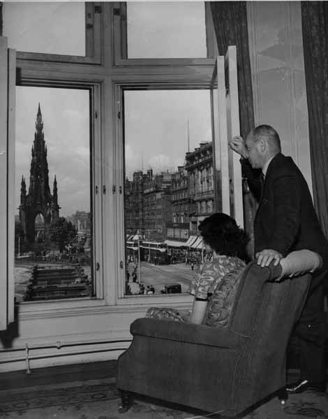 Couple Looking From Window Of The North British Hotel 1950s