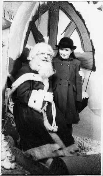 Young Girl With Santa Claus 1940s