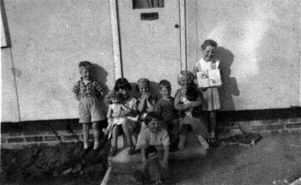 Children On Steps Of Prefab 1950s