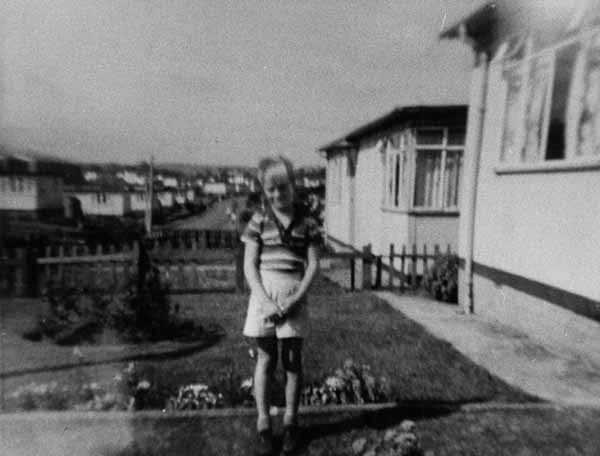 Boy Outside Prefabs 1950s