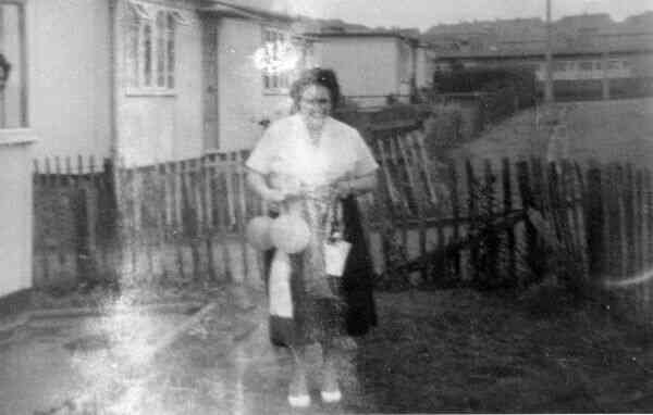 Woman Standing In Garden Outside Prefabs At Moredun c.1954