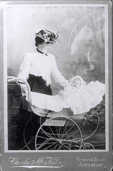 Studio Portrait Woman With Baby In Pram c.1900