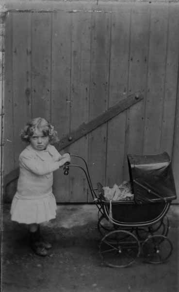 Young Child With Toy Pram 1919