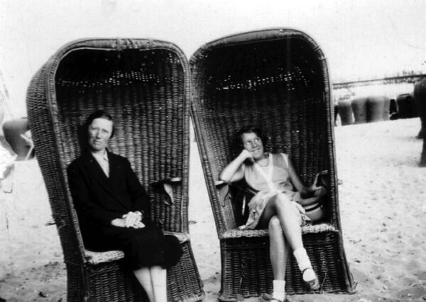 Woman And Girl At The Seaside In Wicker Beach Chairs 1930s