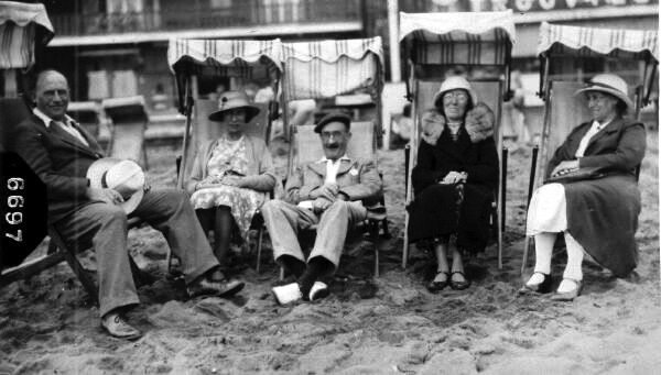 Sitting On Deckchairs At The Beach 1930s