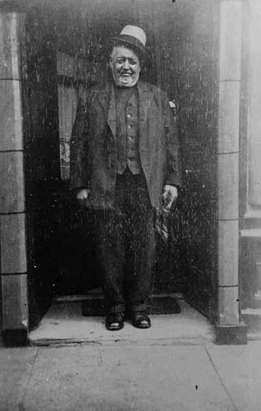 Man Standing In Doorway Of Barber Shop In Main Street 1945