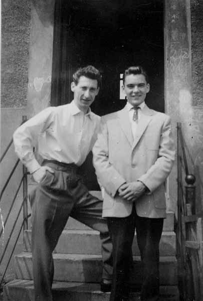 Two Young Men Standing In Doorway 1958