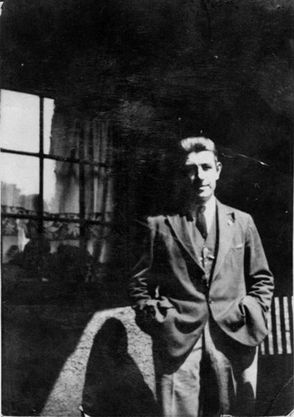 Man Standing In Sunlight By Window In Lawnmarket 1920