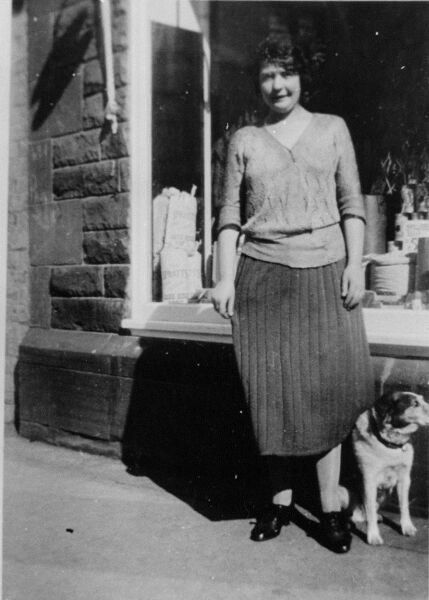 Woman And Dog Standing In Front Of Shop Window 1920s