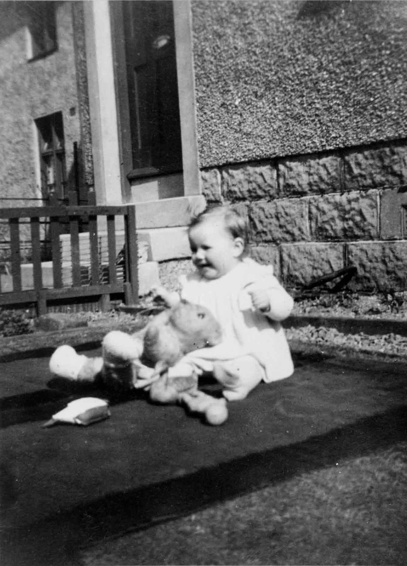 Young Child With Teddy Bear 1948