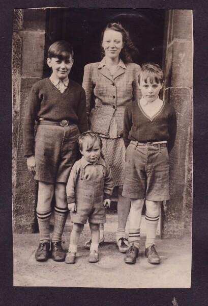 Family Standing In Doorway At 38 Dumbiedykes Road c.1949